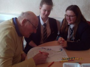 gentleman and two students colouring together for the art project