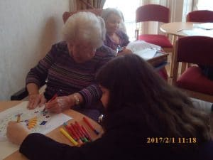 Colour me proud art project - resident colouring with student
