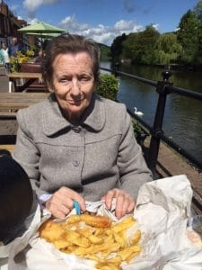 Margaret eating fish and chips next to the river in Bewdley after trip to the museum