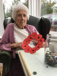 A lady residents poppy tribute