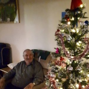 gentleman resident admiring the Christmas tree