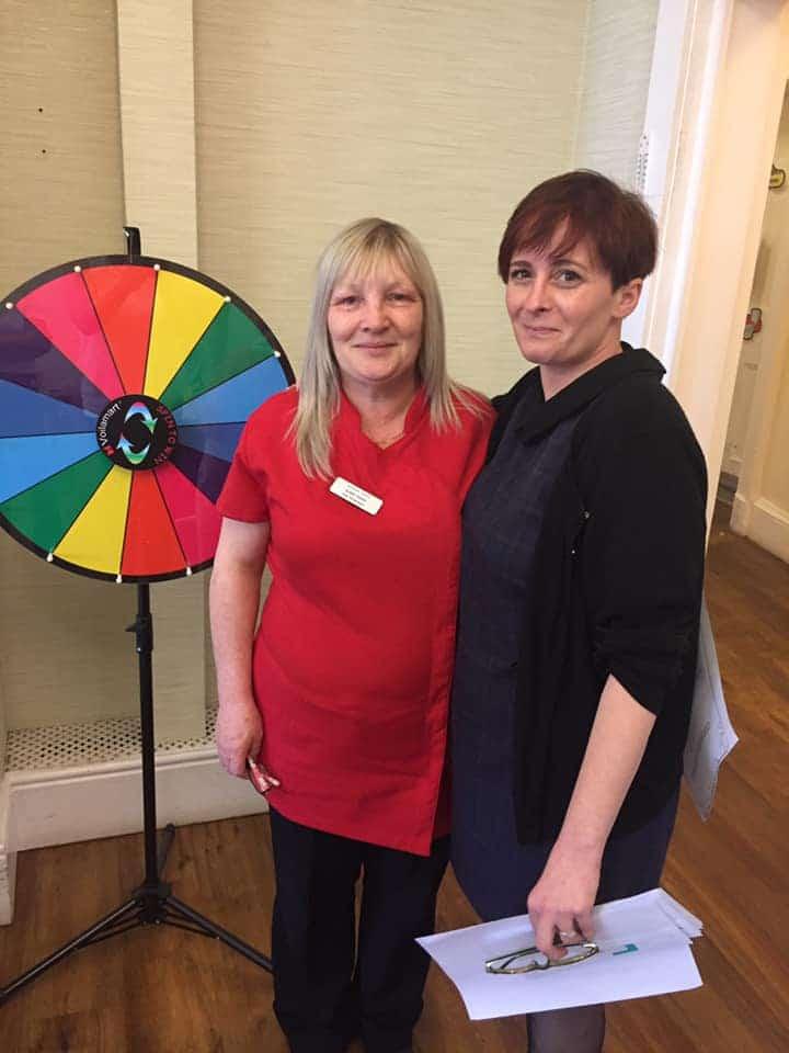awarding achievements - Elaine wheel of fortune