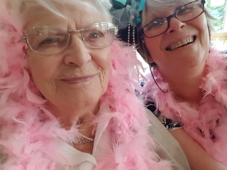 Summer fundraiser - resident with feather boa and Rita