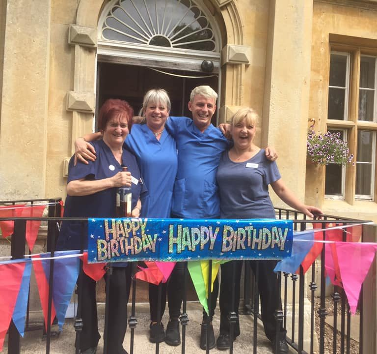 summer celebrations - staff and birthday banner at entrance