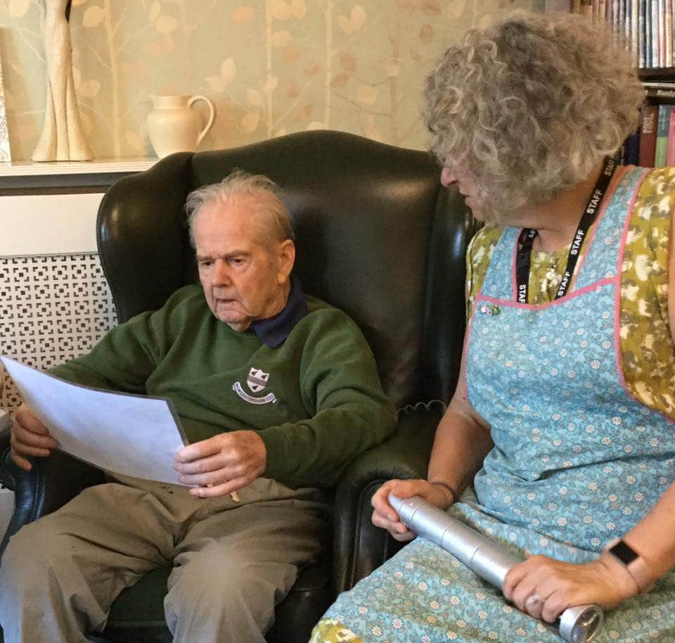 resident looking at map of Normandy Landings