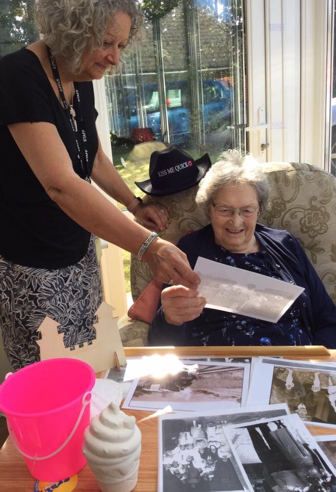 memory lane - resident looking at seaside photos 1