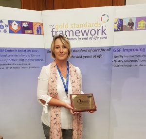 Melanie Dawson receiving the Platinum Award at the GSF cdremony