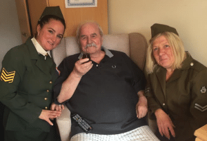 resident reminiscing with staff in WWII uniform - snapshot of a week