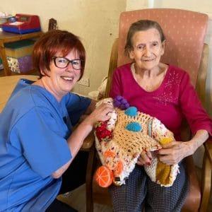 New carer Yvonne and resident with twiddlemat