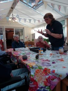garden bird watch - making pinecone feeders