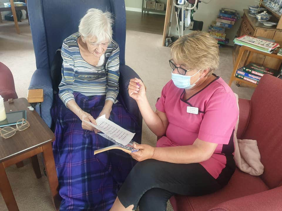 quiet time between a carer and resident during coronavirs