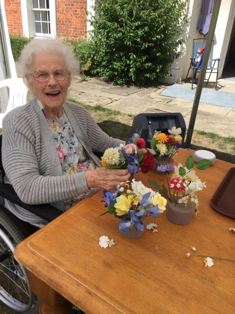 resident flower arranging in the garden