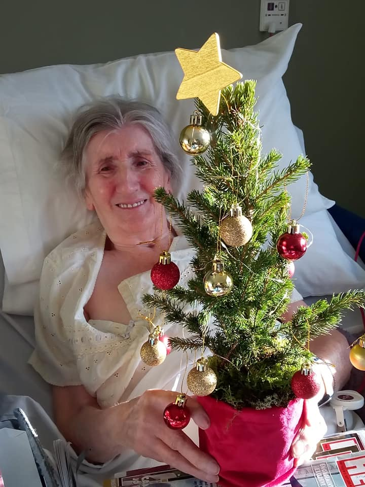 Lady resident and Christmas tree