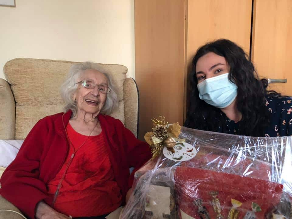 resident and carer with hamper