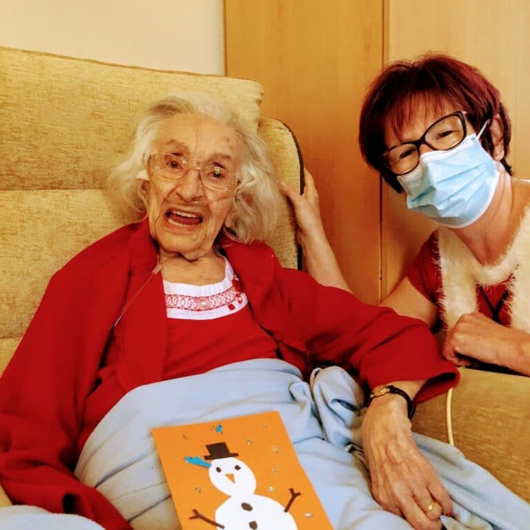 resident and carer with Xmas card - positive message