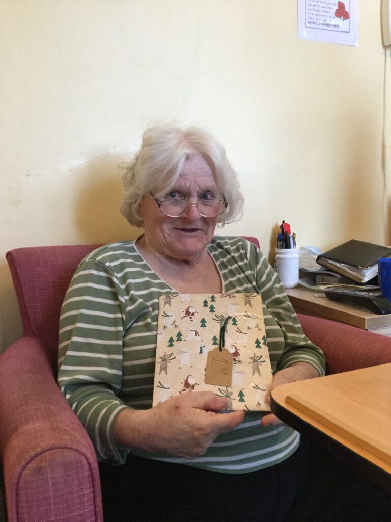 Resident receiving an advent gift
