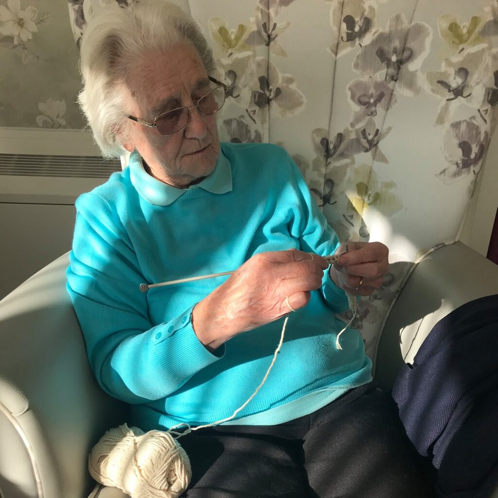 Lady resident knitting - Newstead