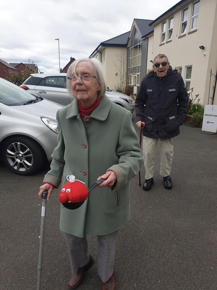 red nose relay - fundraising - lady in sage coat