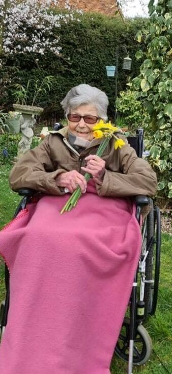 lady in the garden abberton with daffodils