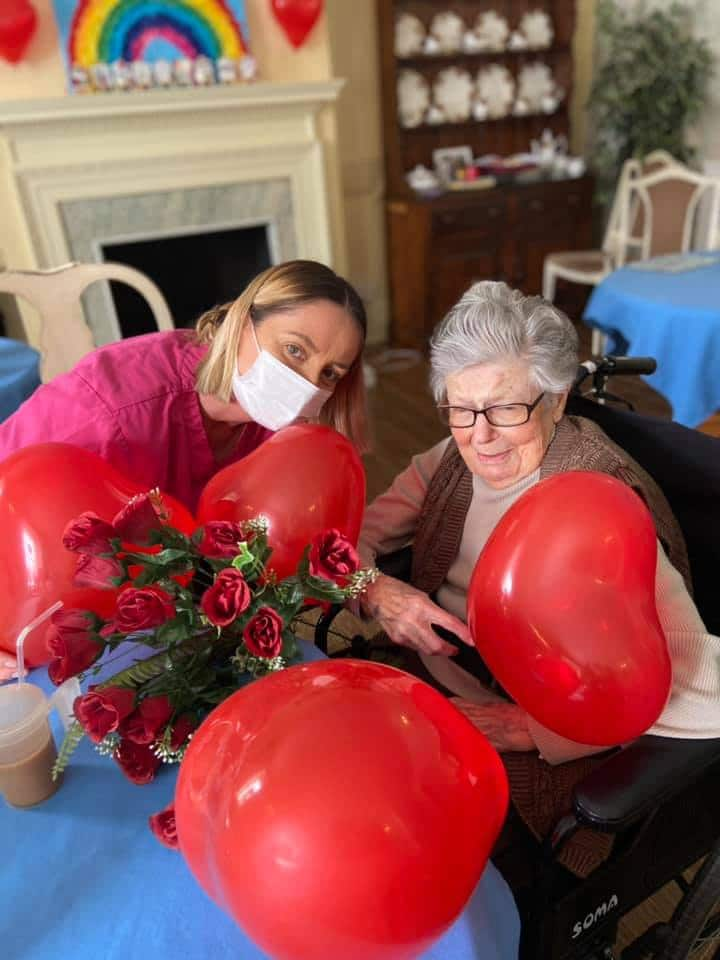 Valentines celebration - resident and lady resident with balloons