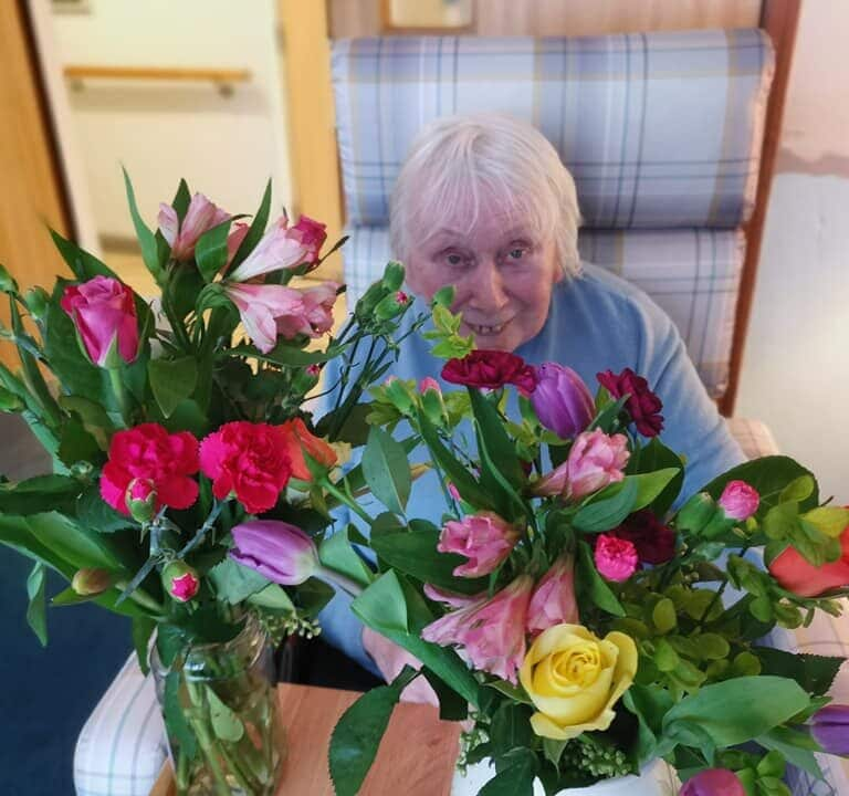 Floristry - lady surrounded by flowers