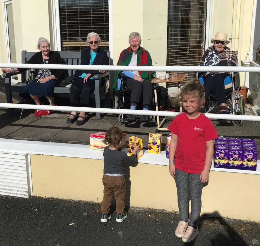 children delivering Easter eggs
