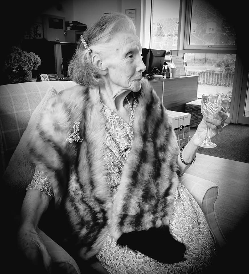 Glitz and glamour - lady in fur stole - Cannes day - b/w
