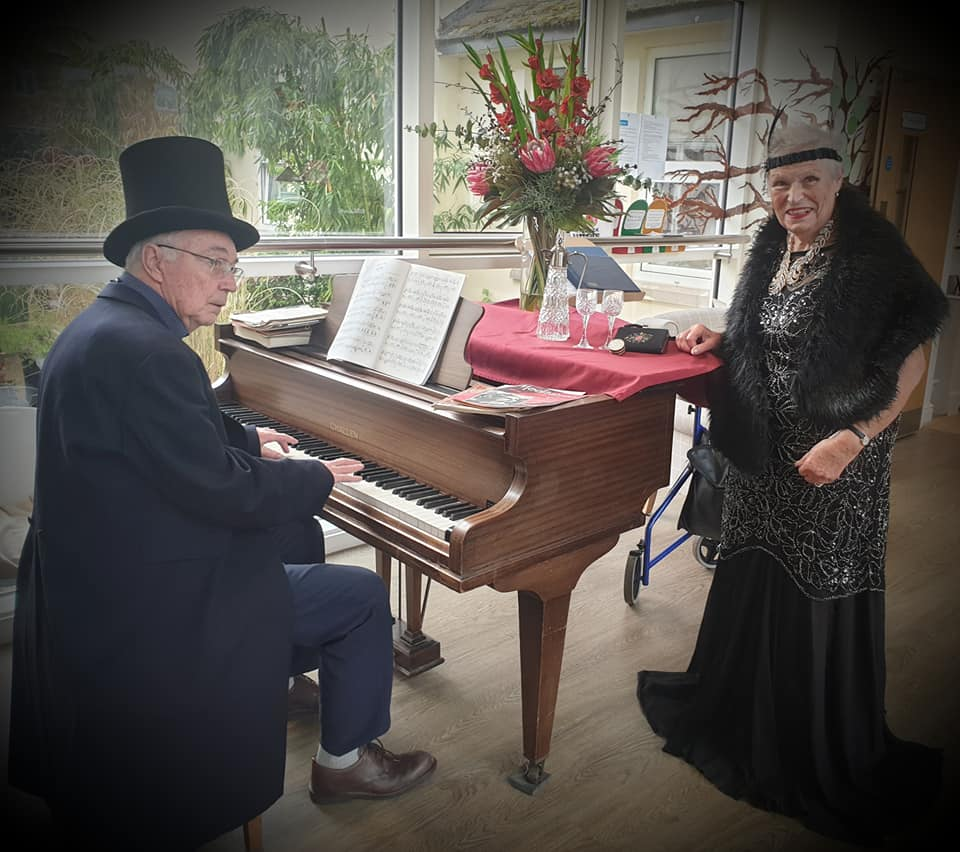 playing the piano and singing - glitz and glamour at The Lawns