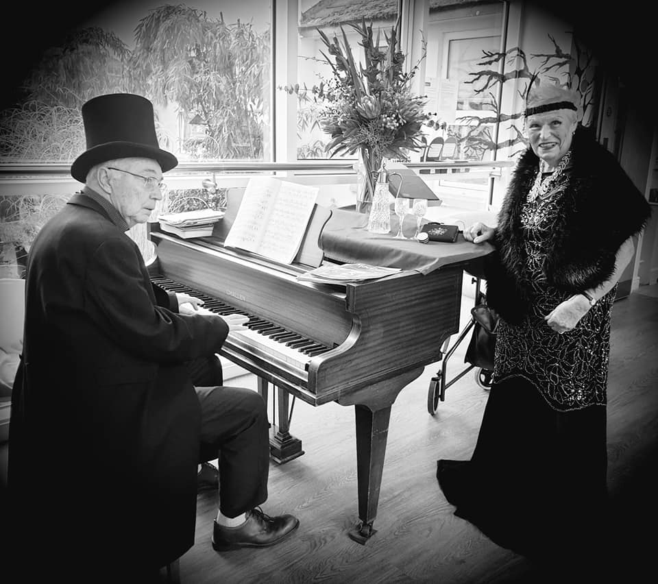 playing the piano and singing - glitz and glamour at The Lawns - b/w