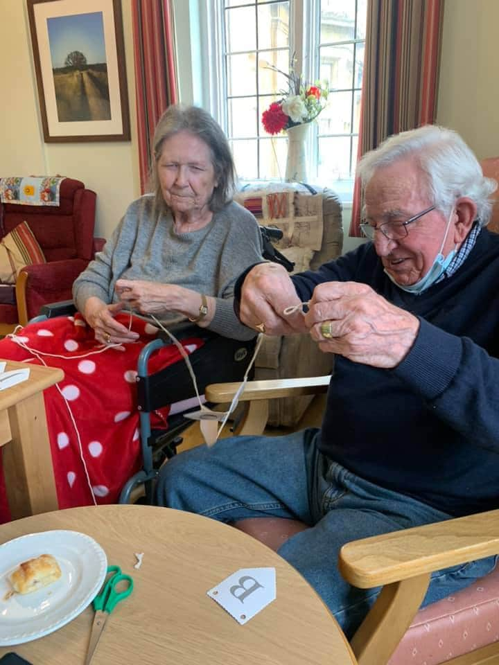 craft collaboration - bunting - two residents Astley
