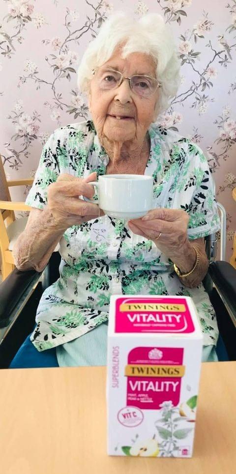 lady drinking Twinings vitality - hydration week