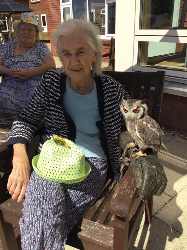 Jean smiling and holding owl - making new memories