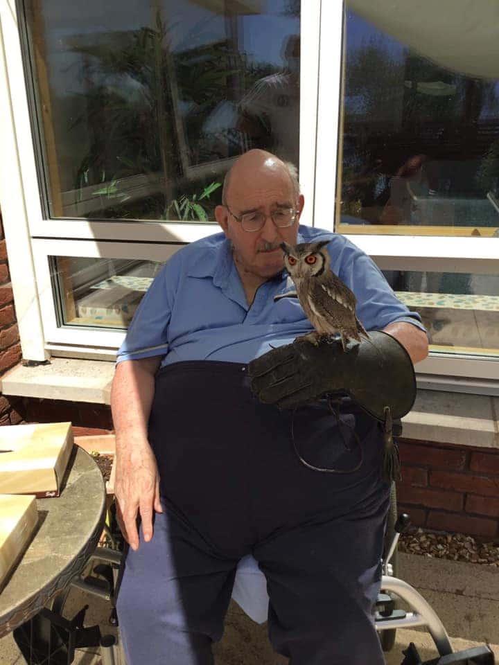 gentleman resident holding an owl