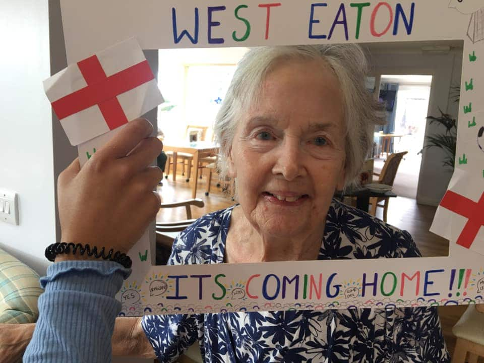 Its coming home! residents in blue flower top with picture window