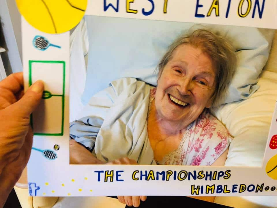 laughing lady resident with Wimbledon picture window