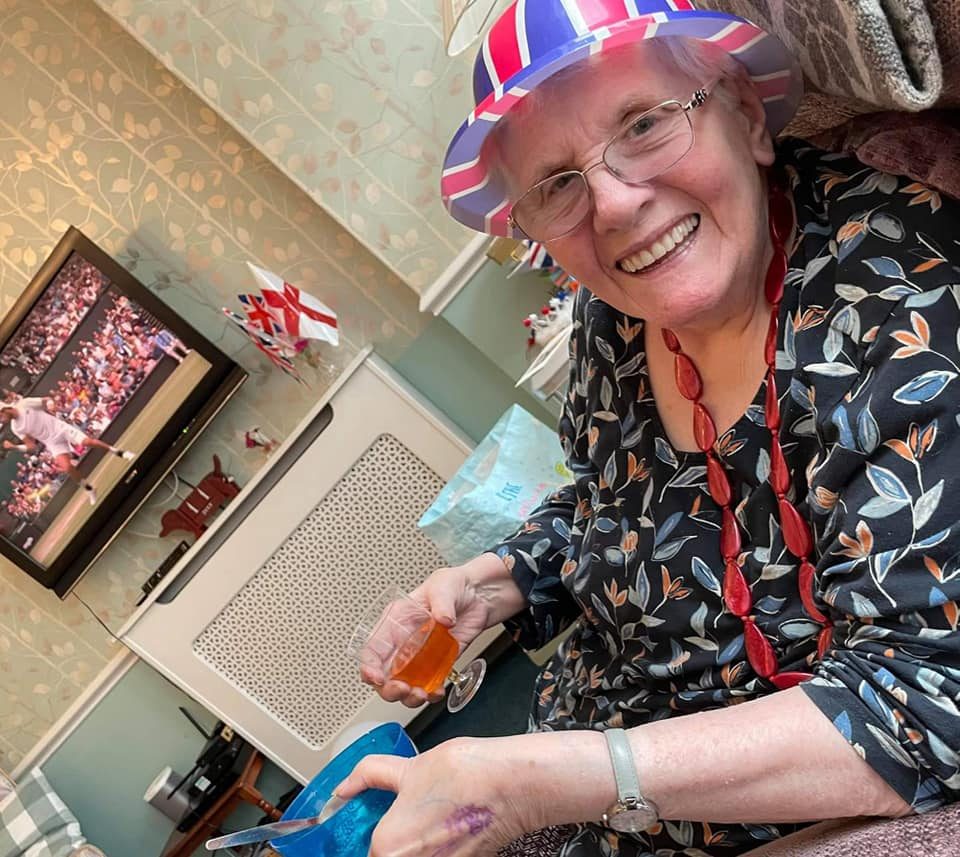 enjoying the tennis - lady with Union Jack hat at Summerdyne