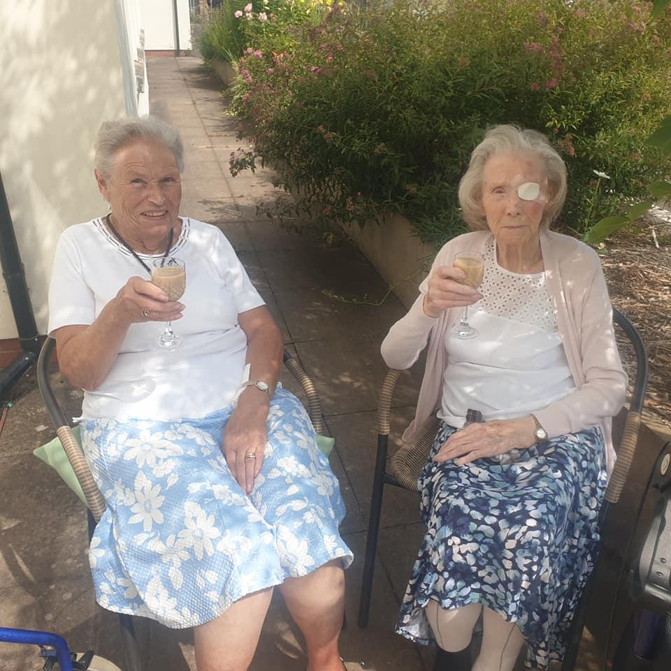 two ladies enjoying a Baileys