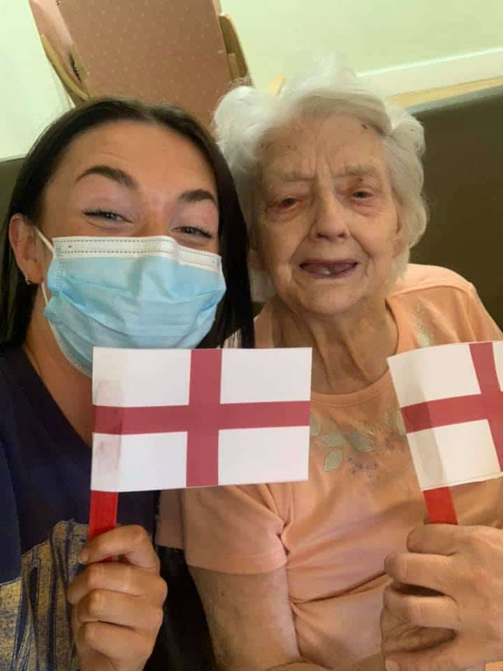 Euros Maddison and lady resident with flags