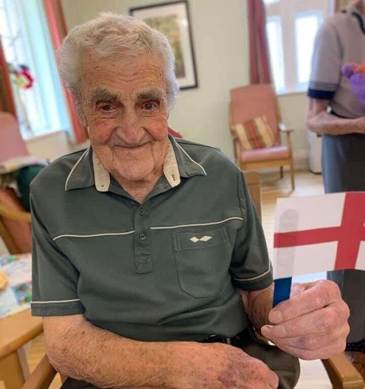 Euros - gentleman in grey shirt with flag