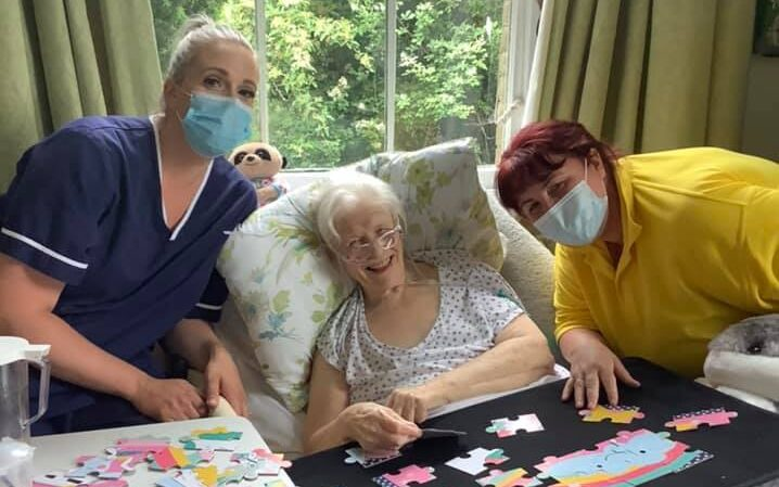lady with 2 team jigsaw puzzling