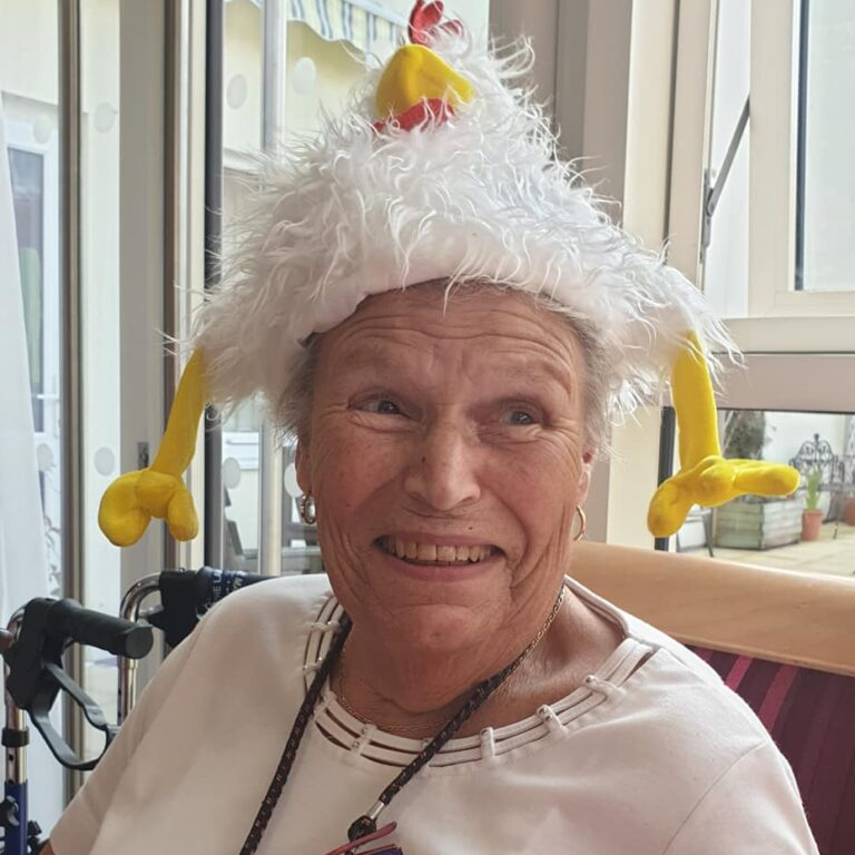 lady with chicken hat - Mad Hatters party